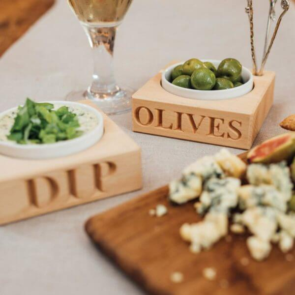 Olive dish with four picks