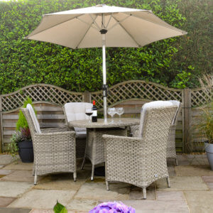 4_seat_parasol_garden_furniture_against_brown_wood_fence