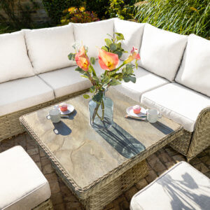 Square_Adjustable_table_with_sofa_on_paving_with_yellow_and_orange_scatter_cushions