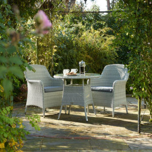 2021 Bramblecrest Tetbury Round Garden Bistro Table Set with a cafetiere full of coffee and 2 mugs on the table