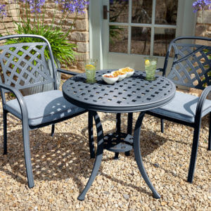 2020 Hartman Berkeley 2 seat garden bistro table- antique grey/platinum set on gravel patio
