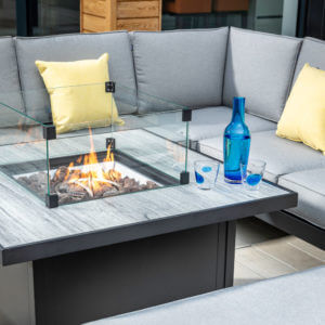 Hartman Atlas Fire pit table with sofa behind
