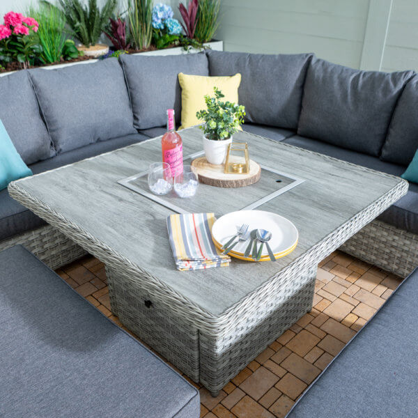 close_up_of+grey_ceramic_garden_table_amongst_sofa_configuration_in_courtyard