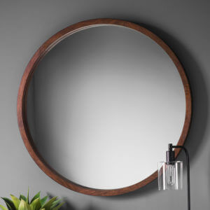 Chic brown round mirror on grey wall