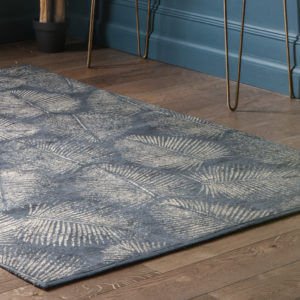 Lyme Coast Rug Charcoal Gold- indoors next to gold table legs
