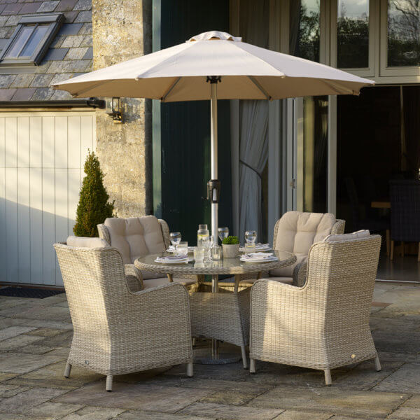 Round_table_Garden_Dining_Set_With_Parasol_On_Paving