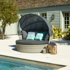 2021 Bramblecrest Monterey Daybed with Canopy in Dove Grey Next To A Pool