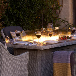 Fire_Pit_dining_table_At_Night_Besides_Glasses_Of_Red_Wine_
