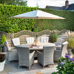 wide_eliptical_garden_dining_table_with_parasol_