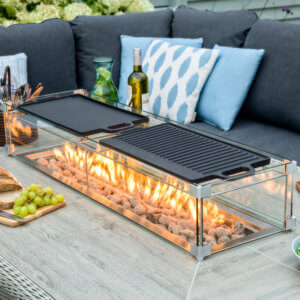 2021 Bramblecrest Double Griddle For Firepit tables with a bottle of wine next to it
