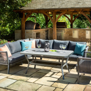 rectangle_table_and_corner_sofa_metal_garden_furniture_in_sunny_courtyard
